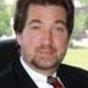 Dr. Charles Meusburger