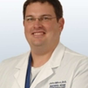 Dr. John Minni