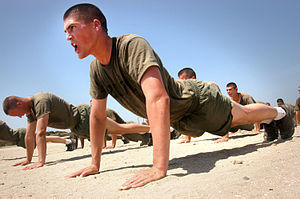 I get exertion headaches when I do pushups. Could I be doing them wrong or is something wrong with my head? I have a history of migraines also.