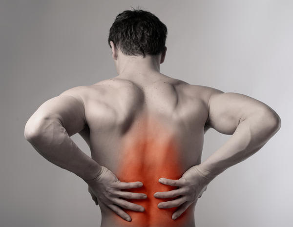 My boyfriend keeps getting an electric shock pain in his back when one spot on his spine in the middle of his back is touched. What's wrong with him?