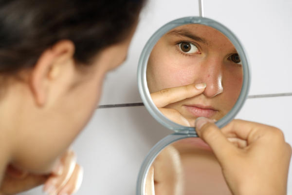 Can you recommend a good way to get rid of pimples and what happens if one pops?