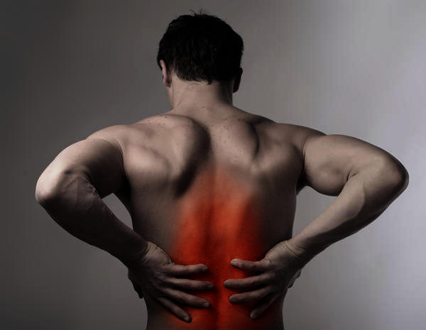 What may be causing lower back pain that radiates from center of lower back around to fronts of thighs?