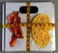 If i were to decrease my intake to 2000 calories and run a mile everyday , how long will it take to lose 15 lbs?
