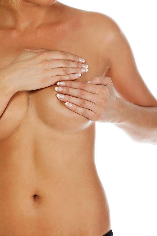 What might a cancerous lump in breast feel like?