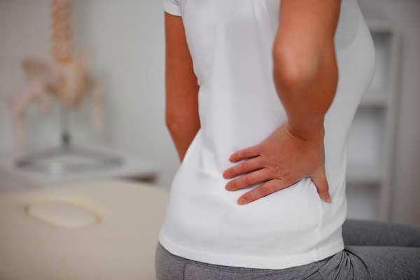 Would someone normally have back pain and lower stomach pain during her period?