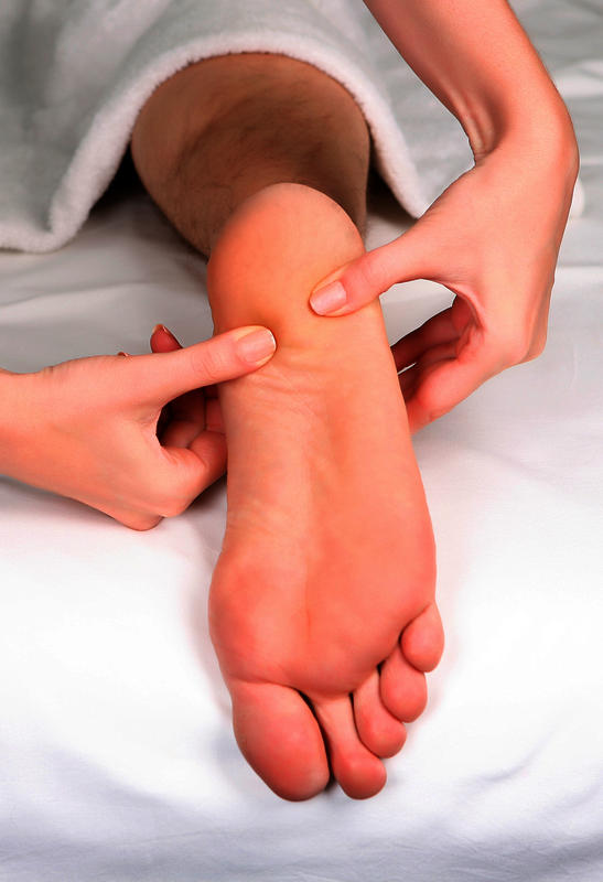 Why do I have tingling in my foot? Could it be related to my back pain?