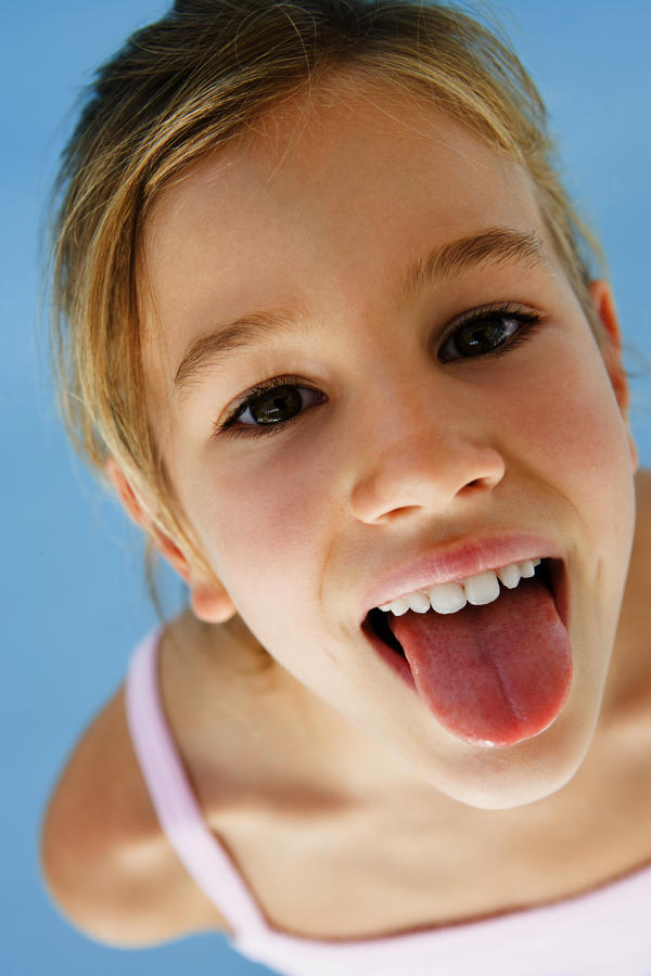Why does tongue have black spots?