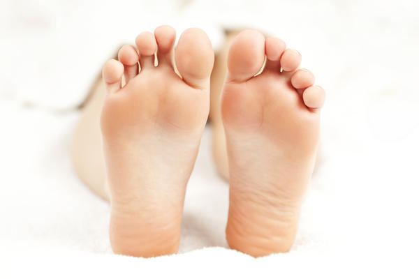 I have corns and calluses on my feet, and sometimes suffer from athletes foot. The sides of my feet are bright pink in colour and flaky, what is it?