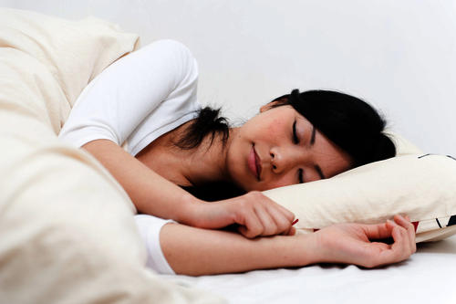 What is the best sleeping position for hemorrhoids?
