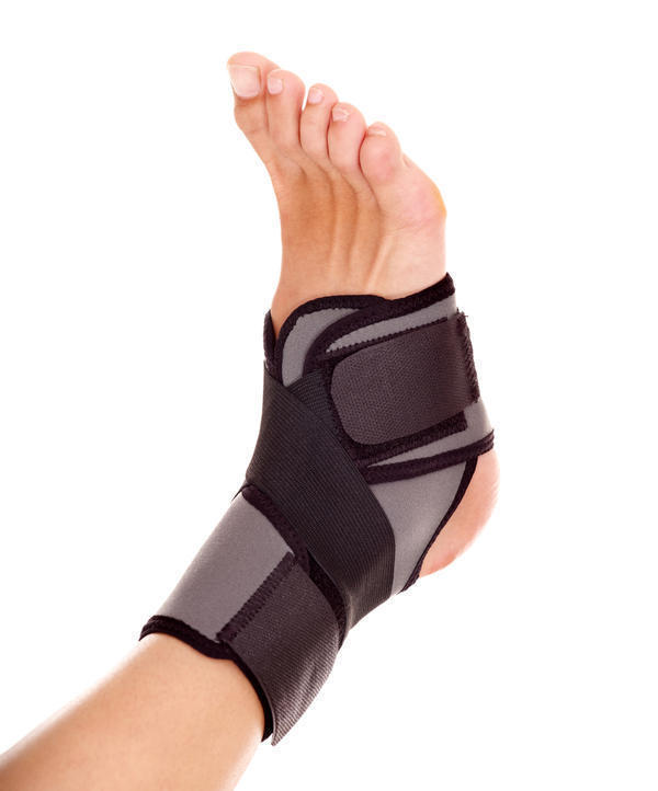 What is the best way to tape a sprained ankle for support during recovery?
