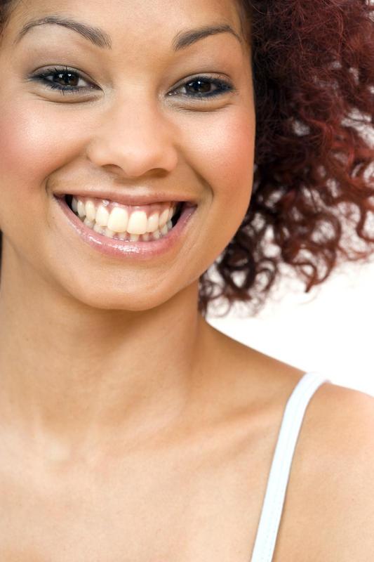 What non-behavioural biological factors affect a person's dental / oral health?