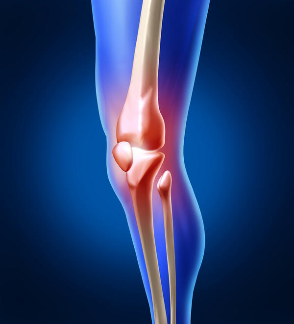 Pain in knee joint and back.