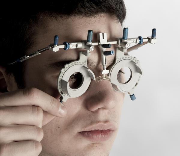 Headache because of eye strain when i'm reading. Do i need glasses?