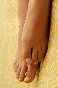 How can I remove an ingrown toenail at home as painlessly as possible?