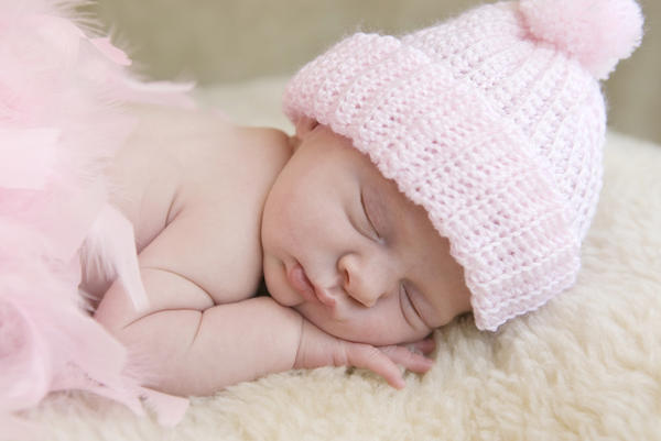 Is it safe to give a 2 week old .25 mg melatonin to help her sleep?