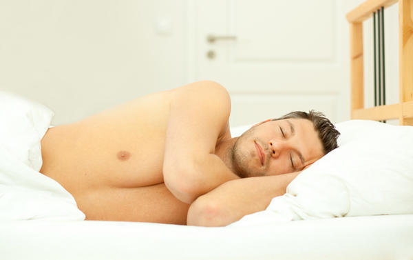 Can anyone tell me what causes a person to stop breathing while asleep?