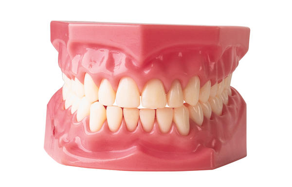 What amount of are dentures per tooth or for partial dentures?