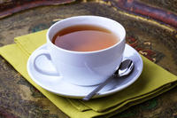 I hear all the benefits of drinking Green Tea daily, how many cups per day do I need to get the benefits? Also, does adding milk ruin the effects?