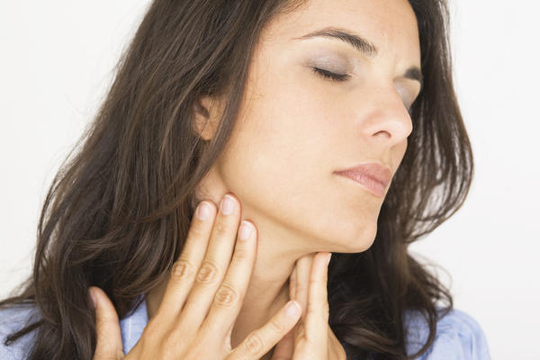 Keep losing my voice sore throat and lumps on both sides of my neck?
