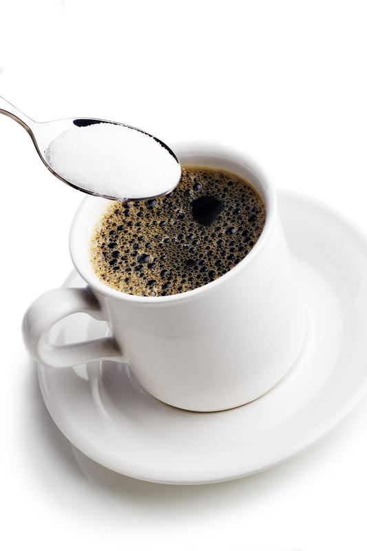 Does black coffee gives more energy or black coffee with sugar to delay sleepiness?