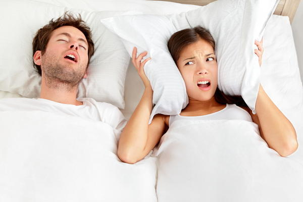 What are symptoms of sleep apnea?