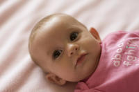 How many times solid food and bottle feed to be given to 6 month old baby?
