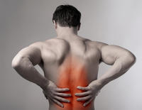 I have chronic back pain. I have had this for 15+ years. The more I move the more I get numbness in my legs. It varies location, what might cause it?