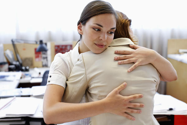 How can I tell the difference between normal back pain and back labor?