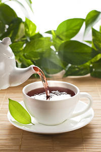 What are the benefits of drinking plain tea or coffee? Does green tea offer more health benefits than other types or are they about equal healthwise?