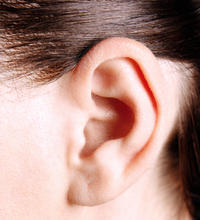 I've noticed that a small- pea size but more flat- pump bone hard &not movable protrudes behind my left ear above lobule but not in right ?worried