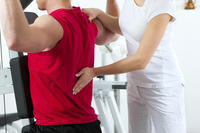 What can you do to treat a lower back strain?