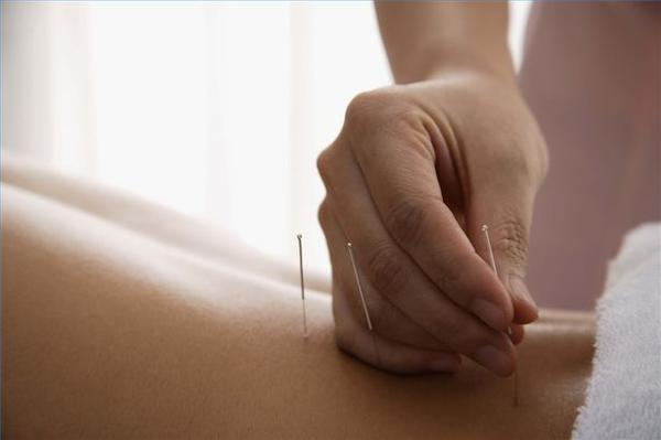 How can I find out about licensing for local holistic practitioners?