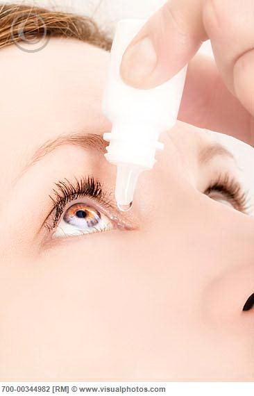 What is the best method of giving a 3-year-old eye drops?