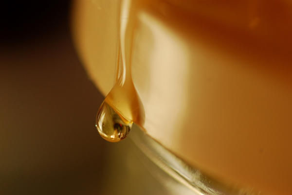 What are the dangers of eating too much honey at one time?  Does honey give you a huge sugar high?