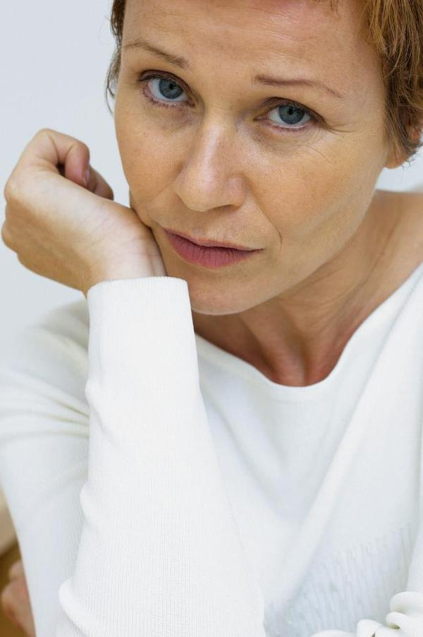What are the symptoms of endometriosis after menopause?