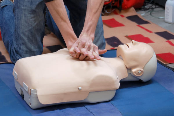 In an emergency, what must I do till paramedics arrive?