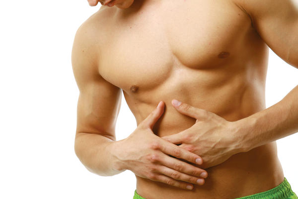What are the symptoms of a stomach muscle injury?  Where would the pain be?