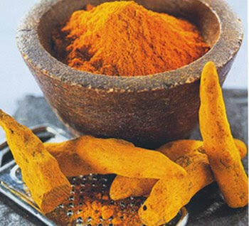 Why is turmeric in hot milk given as an analgesic in folk medicine?