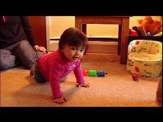 What is the normal age for a baby girl to start crawling?