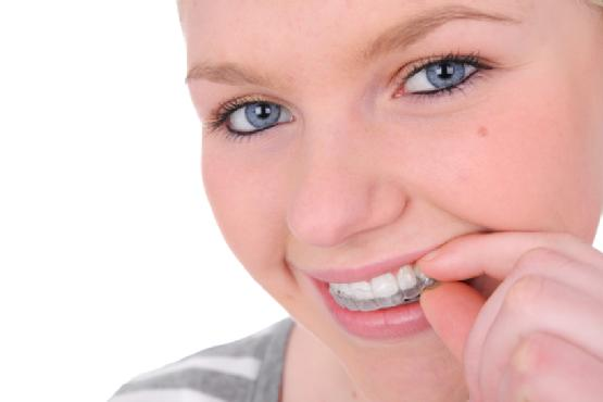 At what age can a child wear invisalign instead of regular braces?