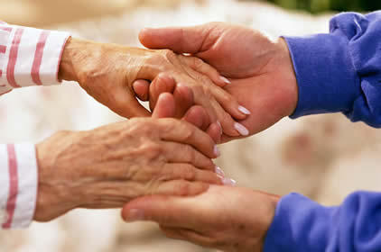 How should one talk to an elderly parent about moving to a nursing home?