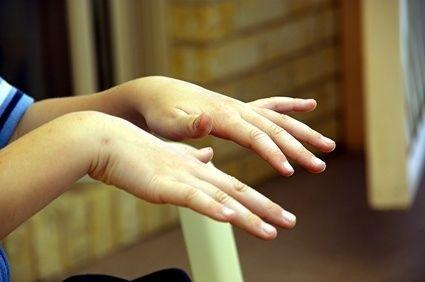 Is a hand tremor a sign of diabetes or something benign?