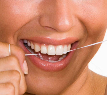 How can I make flossing more of a habit?