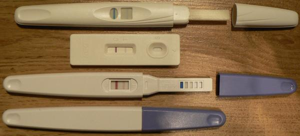 I took an accu clear pregnancy test the circle it look like line the goes cross plus the line goes up and almost half-way the another line goes updown?