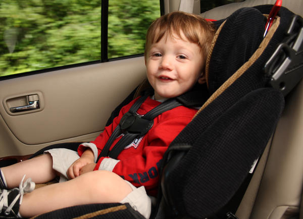 When can kids ride in the car facing forward?