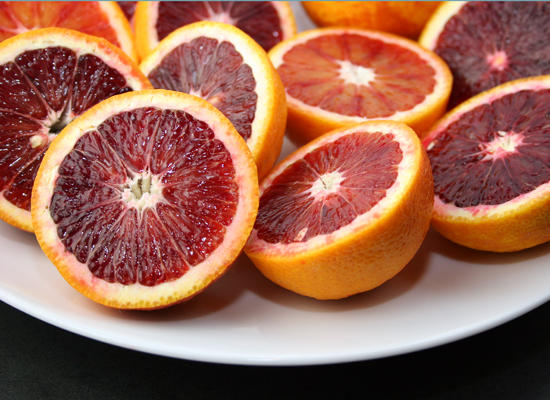 Why is my period a bright reddish orange in color?