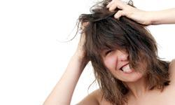 How does stress affect dandruff?