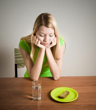 Why do some girls with eating disorders eventually lose their teeth?