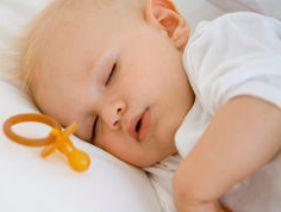 When does a baby sleep through the night soundly?