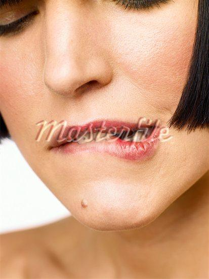 What can be done about a bottom lip infection from lip biting?